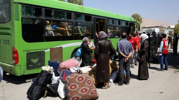 The displaced Darayya residents will be taken to a temporary housing area nearby. AP