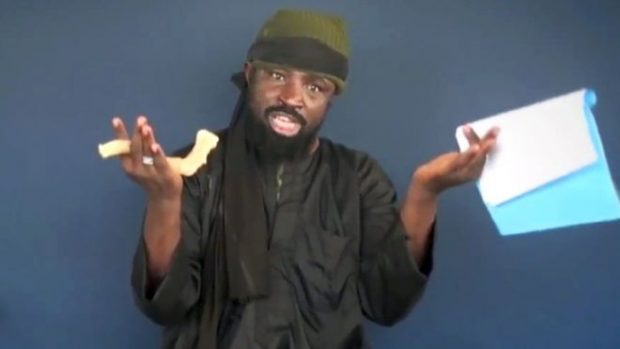 """Shekau, seen here in a video last year, said he was in a """"happy state"""""""