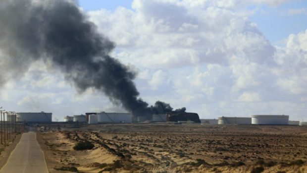 Black smoke billows out of a storage oil tank in the port of Es Sider in Ras Lanuf. REUTERS/Stringer