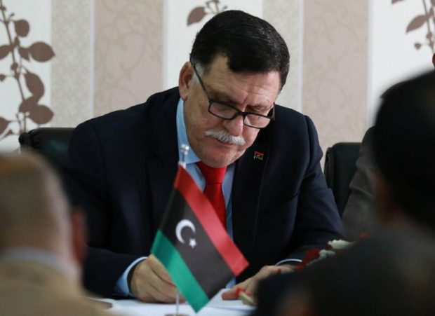 Libya's Prime minister-designate Fayez al-Sarraj chairs a Presidential Council of the Government of National Reconciliation meeting with local mayors inside the naval base in the Libyan capital Tripoli on April 3, 2016 (AFP Photo/Mahmud Turkia)