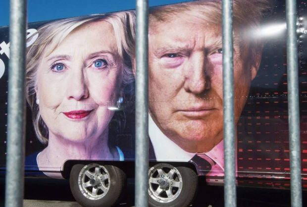 Large images of Democratic U.S. presidential nominee Hillary Clinton and her Republican rival, Donald Trump, are seen Saturday on a CNN vehicle at Hofstra University in Hempsted, New York, which is to host the first presidential debate Monday.   AFP-JIJI