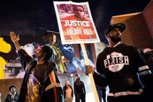 Protesters rally at the sight of riots in Baltimore in April 2015. SHAWN THEW / EPA