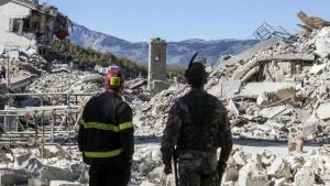A firefighter, left, and an alpine soldier look at rubble in the hilltop town of Amatrice as an earthquake with a preliminary magnitude of 6.6 struck central Italy, Sunday, Oct. 30, 2016. A powerful earthquake rocked the same area of central and southern Italy hit by quake in August and a pair of aftershocks last week, sending already quake-damaged buildings crumbling after a week of temblors that have left thousands homeless. (Massimo Percossi/ANSA via AP)  (The Associated Press)