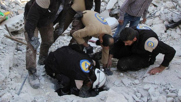 Syrian civil defence volunteers search for victims amid the rubble of destroyed buildings on October 24, 2016, following overnight air strikes in the rebel-held town of Kafar Takharim, in Idlib province of northwest Syria. / AFP / Omar haj kadour        (Photo credit should read OMAR HAJ KADOUR/AFP/Getty Images)