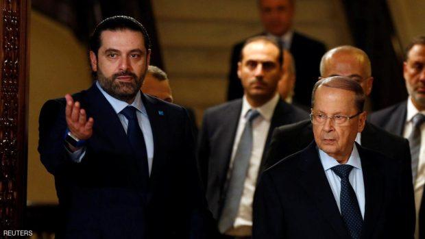 Christian politician and FPM founder Michel Aoun (L) walks next to Lebanon's former prime minister Saad al-Hariri. REUTERS/Mohamed Azakir