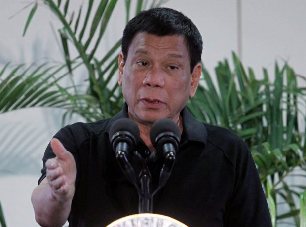 Philippines President Rodrigo Duterte gestures during a news conference upon his arrival from a state visit in Vietnam at the International Airport in Davao city, Philippines Sept. 30, 2016. Lean Daval Jr. / Reuters