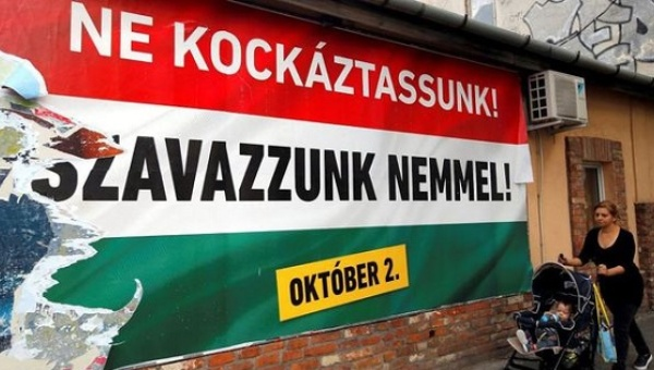 """A Hungarian government's poster in Budapest, Hungary, Sept. 28. The poster reads: """"We should not take a risk, vote no (to refugees)."""" 