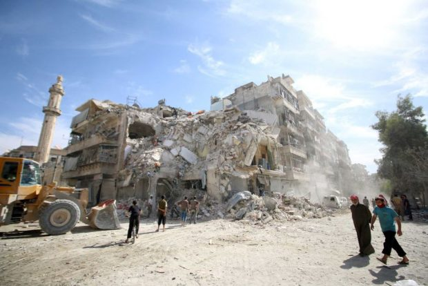 People inspect the damage after an air strike in Aleppo. Reuters: Abdalrhman Ismail