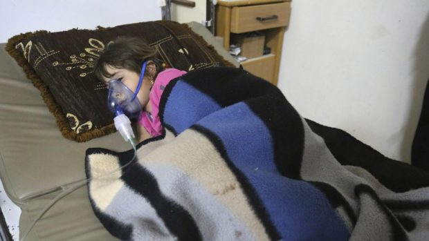 A girl, affected by what activists say was a gas attack, receives treatment inside a makeshift hospital in Kfar Zeita village in the central province of Hama. REUTERS/Badi Khlif