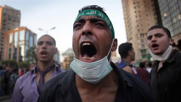 File photo shows supporters of Egypt's banned Muslim Brotherhood movement protesting in the capital, Cairo. (Photo by AP)