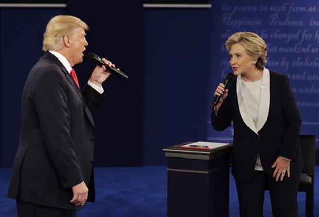 Republican presidential nominee Donald Trump and Democratic presidential nominee Hillary Clinton speak during the second presidential debate at Washington University in St. Louis, Sunday. AP Photo/John Locher
