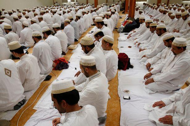 An Ashura celebration for men in an Anjuman-E-Burhani Mosque