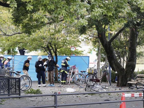 Police inspect the scene for the blast in the car park (AP)