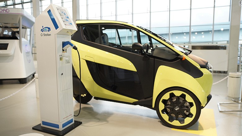 The Toyota iRoad at a charging station.
