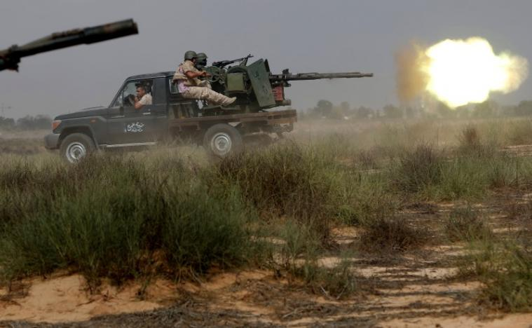 Libyan forces allied with the U.N.-backed government fire weapons during a battle with Islamic State fighters in Sirte. REUTERS/Goran Tomasevic