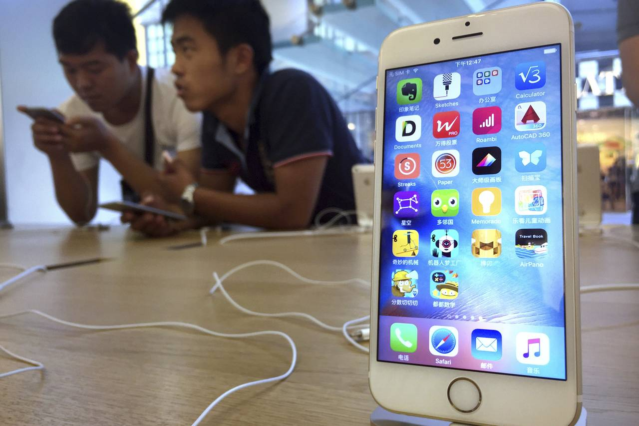 Apple said it will offer free replacements of iPhone 6s batteries for consumers whose smartphones unexpectedly shutdown. Here, an Apple iPhone 6S on display at an Apple Store in Beijing on June 18, 2016. Photo: Associated Press