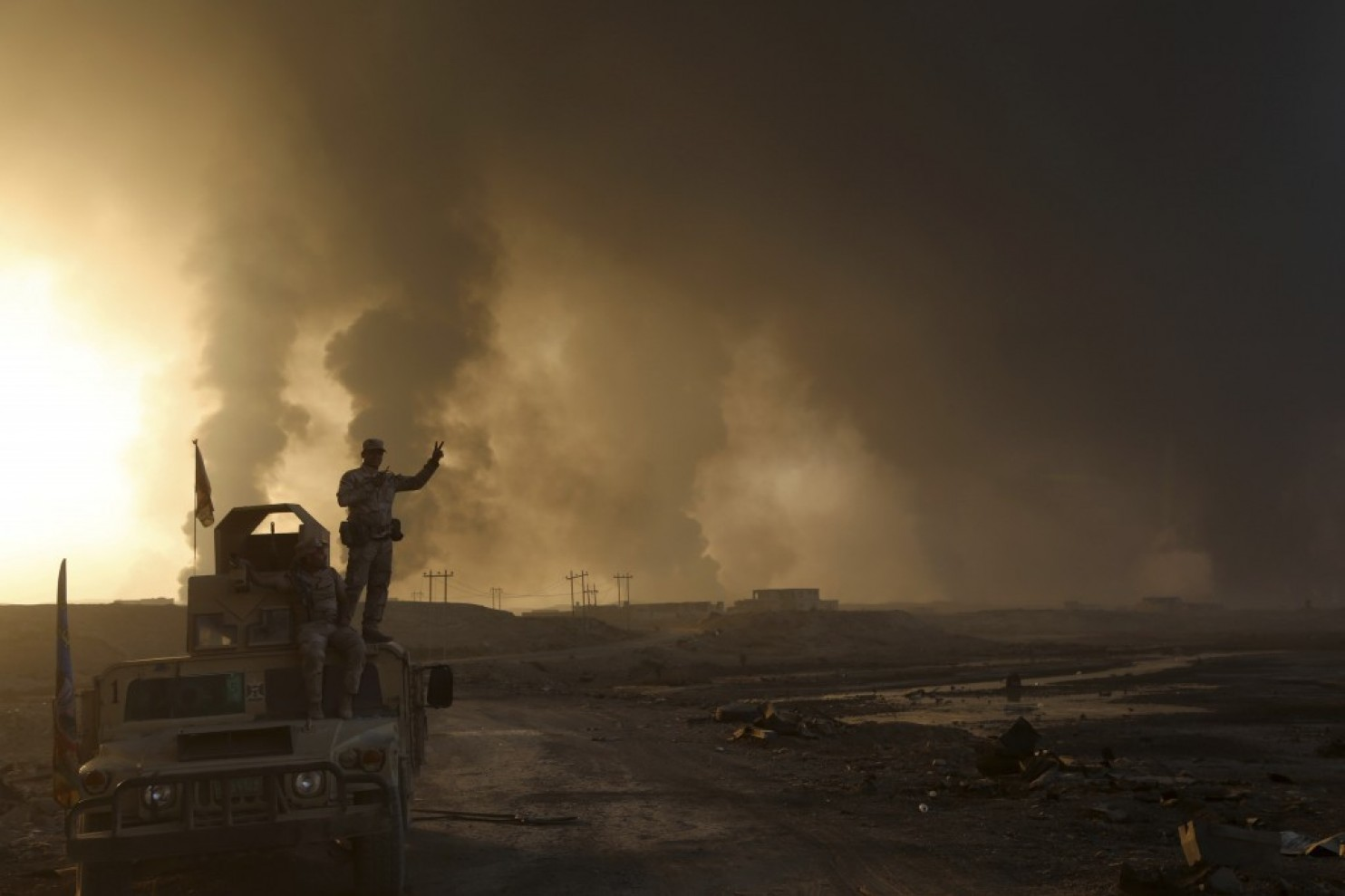 Smoke rises from Islamic State positions after an airstrike by coalition forces in Mosul, Iraq, on Oct. 18. (AP)
