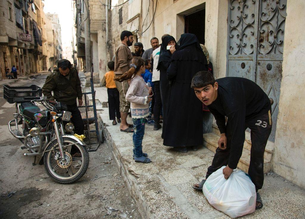 More than 250,000 civilians remain under siege in Aleppo as the Syrian army advances (AFP Photo/KARAM AL-MASRI)