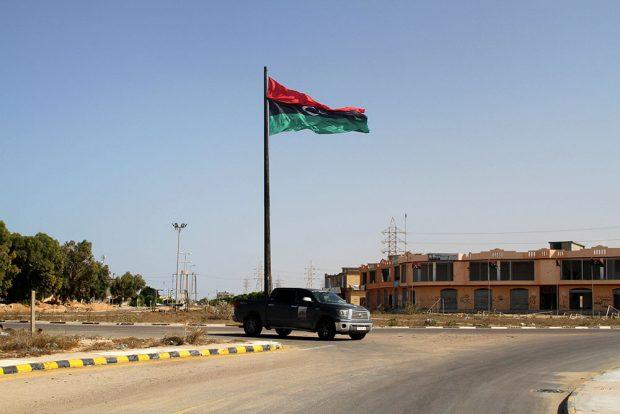 A Libyan flag flies at the entrance of Sirte, Libya October 30, 2016. REUTERS/Hani Amara