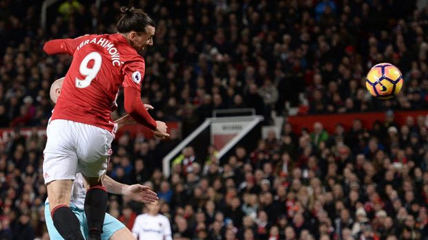 Manchester United's Swedish striker Zlatan Ibrahimovic leaps to head the ball and score their first goal to equalise 1-1 during the English Premier League football match between Manchester United and West Ham United at Old Trafford in Manchester, north west England, on November 27, 2016. OLI SCARFF/AFP/Getty Images