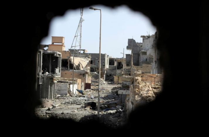 A view from a hole in a wall shows houses and buildings that were destroyed during a battle between Libyan forces allied with the U.N.-backed government and Islamic State militants, in neighborhood Number Three in Sirte, Libya, October 10, 2016. REUTERS/Ismail Zitouny