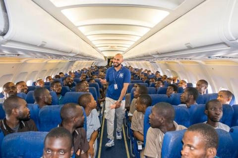 Migrants voluntarily return home to Nigeria with an IOM charter flight from Libya.