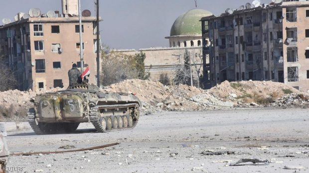 A Syrian government soldier rides a military vehicle near a mosque, after taking control of Aleppo's Al-Haidariya neighbourhood, Syria in this handout picture provided by SANA on November 28, 2016. SANA/Handout via REUTERS