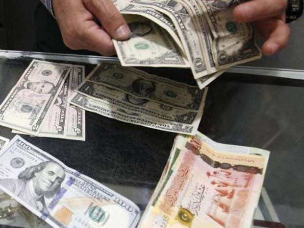 Central Bank Drops Dollar Purchase Fees